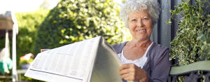 Senior woman reading a newspapeer